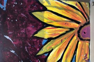 Gayle's sunflower painting is on the cover of 2018 Annual Report